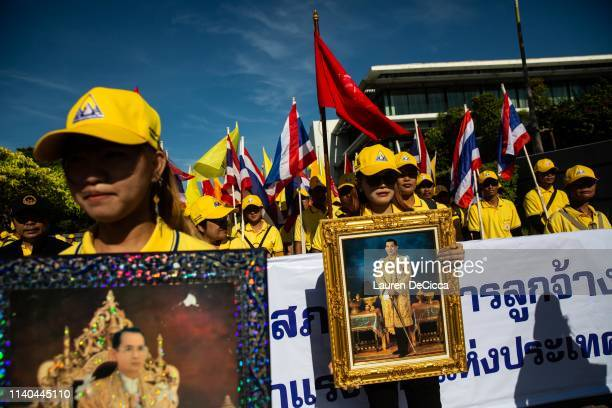 Thai union members hold portraits of King Rama X and his father the late King Rama IV in a Labor Day parade on May 1 2019 in Bangkok Thailand The...