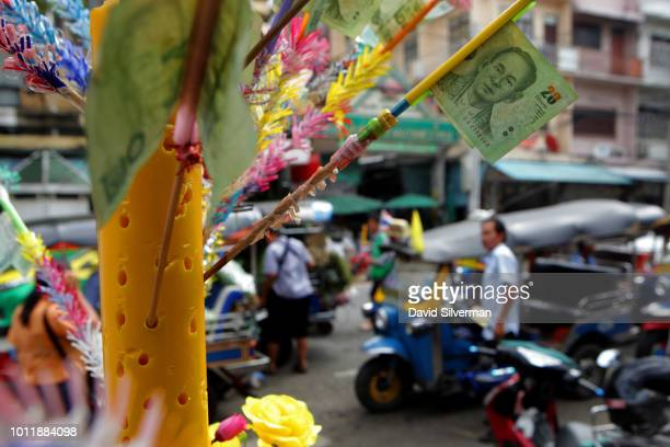Thai vendors prepare flower wreaths which the Buddhist faithful give as offerings during Asahna Bucha celebrations on July 27 2018 in Bangkok...