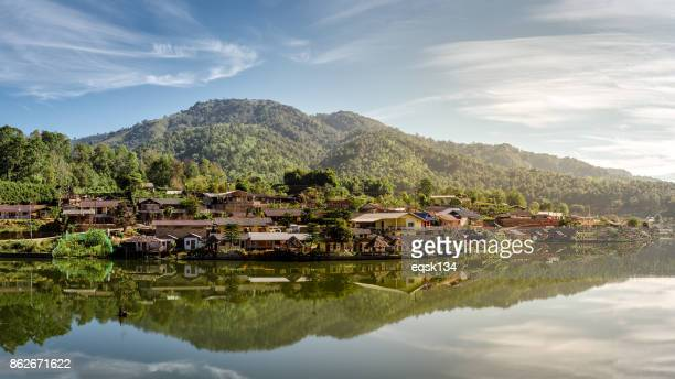 Thai Village in Mountain reflect on river