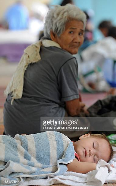 Thai villagers gather at a temporary camp after being evacuated from their homes following a deadly exchange of gunfire between Thai and Cambodian...