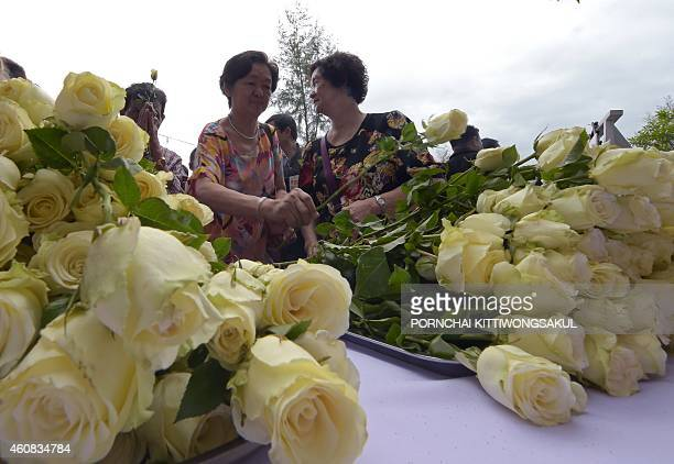 Thai villagers take part in remembrance ceremonies to mark the tenth anniversary of the 2004 tsunami at the Ban Nam Khem tsunami memorial park in...