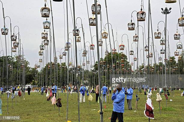 Thai villagers watch birds hanging up during a birdsinging contest in Thailand's restive southern Narathiwat province on June 12 2011 AFP PHOTO/...