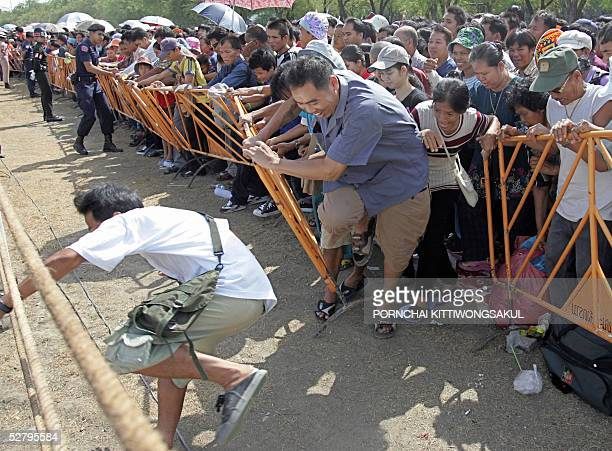 Thai visitors battle for rice seeds during the annual royal ploughing ceremony in Bangkok 11 May 2005 The Thai royal soothsayer predicted plenty of...
