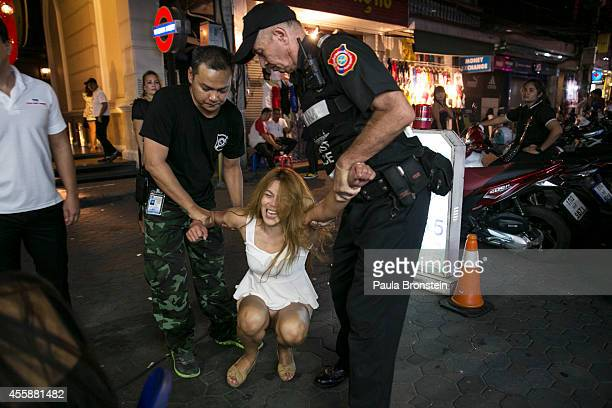 Thai woman is controlled by police in the red light district September 21 2014 in Pattaya Thailand Pattaya is tackling sex tourism and crime as the...