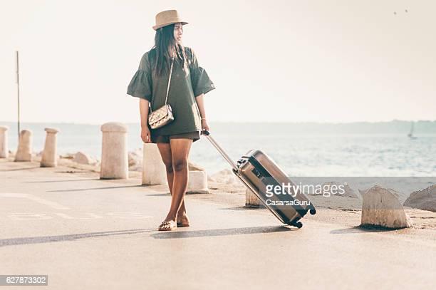 Thai Woman Tourist waiting for Transportation
