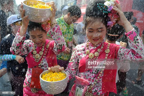 Thai women are splashed with water during Songkran Festival The Songkran festival is the traditional Thai new years it is celebrated annually in...