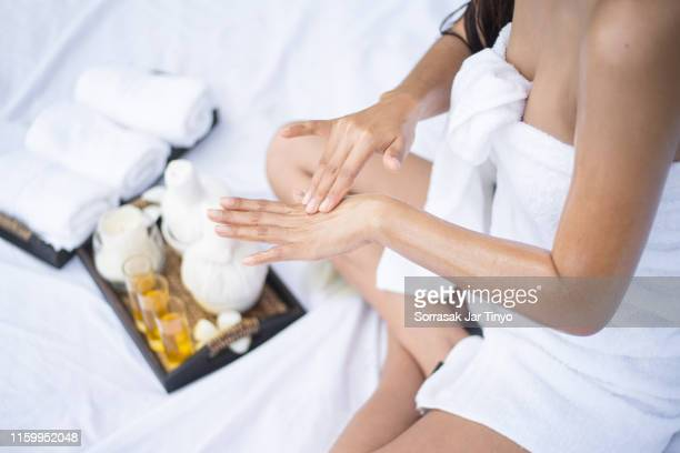 thai women having massage with massage oil at her hand - essential oil stock pictures, royalty-free photos & images