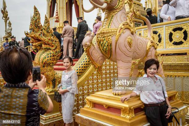 Thai women pose for a picture at the Royal Crematorium site during the opening ceremony visit one day before the general opening for public The Royal...