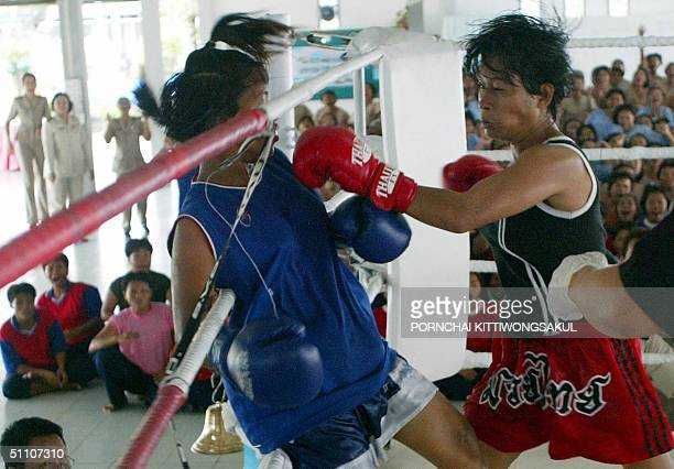 Thai women prisoners exchange punches during the woman prisoner boxing competition in Pathum Thani province suburb of Bangkok 23 July 2004 The woman...