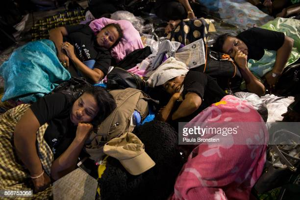 Thai women sleep on the streets on the day of the historical cremation of Thailand's King Bhumibol on October 26 2017 in Bangkok Thailand The funeral...
