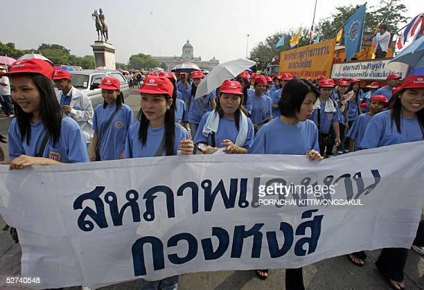 Thai women worker hold demonstrate banners during parade to celebrate for Labour Day in Bangkok 01 May 2005 About 3000 Thai workers join the parade...