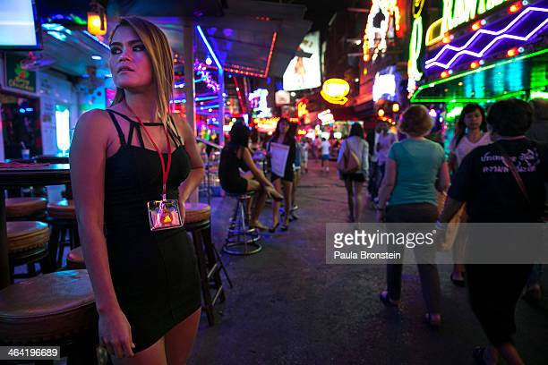 Thai women working at a bar wait for business at the red light district called Soi Cowboy in Bangkok January 21 2014 The popular sex tourism area...