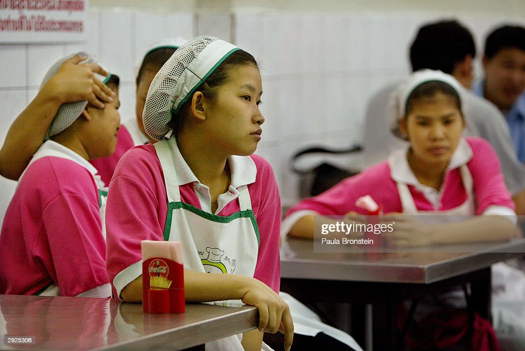 A Thai worker waits for customers at a popular chicken and rice restaurant February 3, 2004 in Bangkok, Thailand. An outbreak of bird flu has ravaged poultry farms and could devastate the country's chicken export sector, worth 1.5 billion dollars, which is the fourth largest in the world. Although the Thai government is trying to calm its people about the deadly virus, fear of eating chicken has affected restaurants, with business remaining slow.
