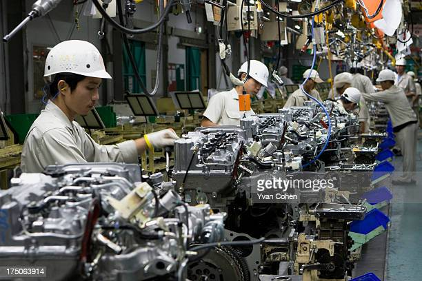 Thai workers on the production line at the Auto Alliance automobile plant at the Hemaraj Eastern Seaboard Industrial Estate in Rayong province about...