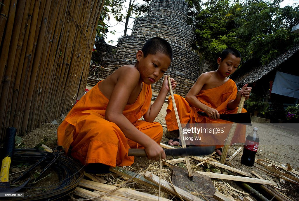 Thai young monks cut bamboo preparing for upcoming Loy Krathong Festival at Wat Phan Tao on November 26, 2012 in Chiang Mai, Thailand. Chiang Mai is the largest and most culturally significant city in northern Thailand. It's a former capital of the Kingdom of Lanna (1296-1768) and was the tributary Kingdom of Chiang Mai from 1774 until 1939. In recent years, is has become an increasingly modern city and has been attracting over 5 million visitors each year, of which between 1.4 million and 2 million are foreign tourists.