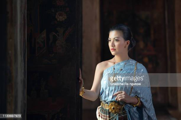 thai young woman wearing thai traditional costume in temple of thailand. - prayer pose greeting bildbanksfoton och bilder
