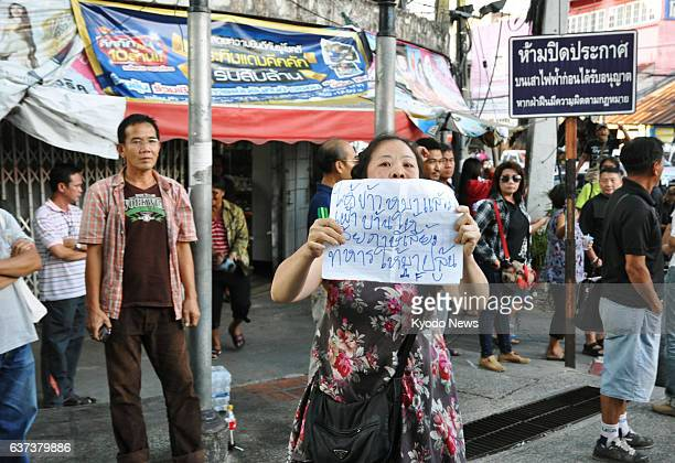 MAI Thailand A woman in Chiang Mai northern Thailand on May 24 holds a protest sign denouncing the military coup in the country