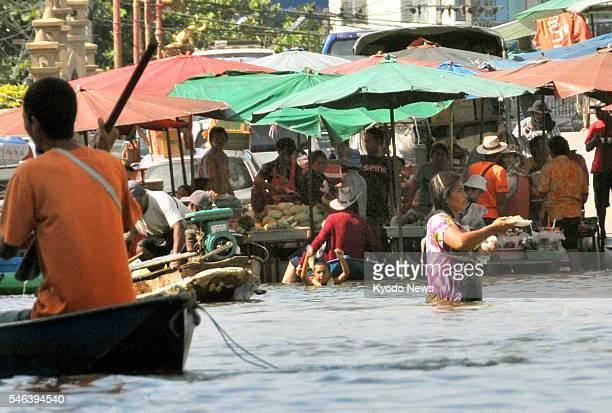 BANGKOK Thailand An outdoor market operates despite major flooding in Nonthaburi Province near Bangkok on Nov 1 2011