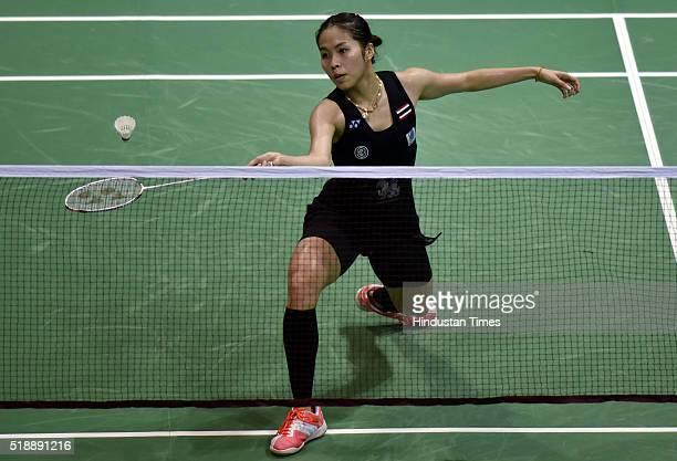 Thailand Badminton player Ratchanok Intanon in action against Chinese Badminton player Li Xuerui at women's final match during the YonexSunrise India...