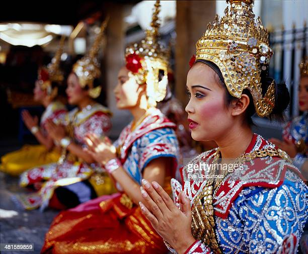 Thailand, Bangkok, Erawan Shrine. Dancers performing for devotees who give thanks for good luck received.