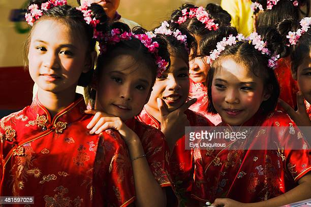 Thailand Bangkok High School girls in Chinese Cheong sam dress in parade celebrating local temple