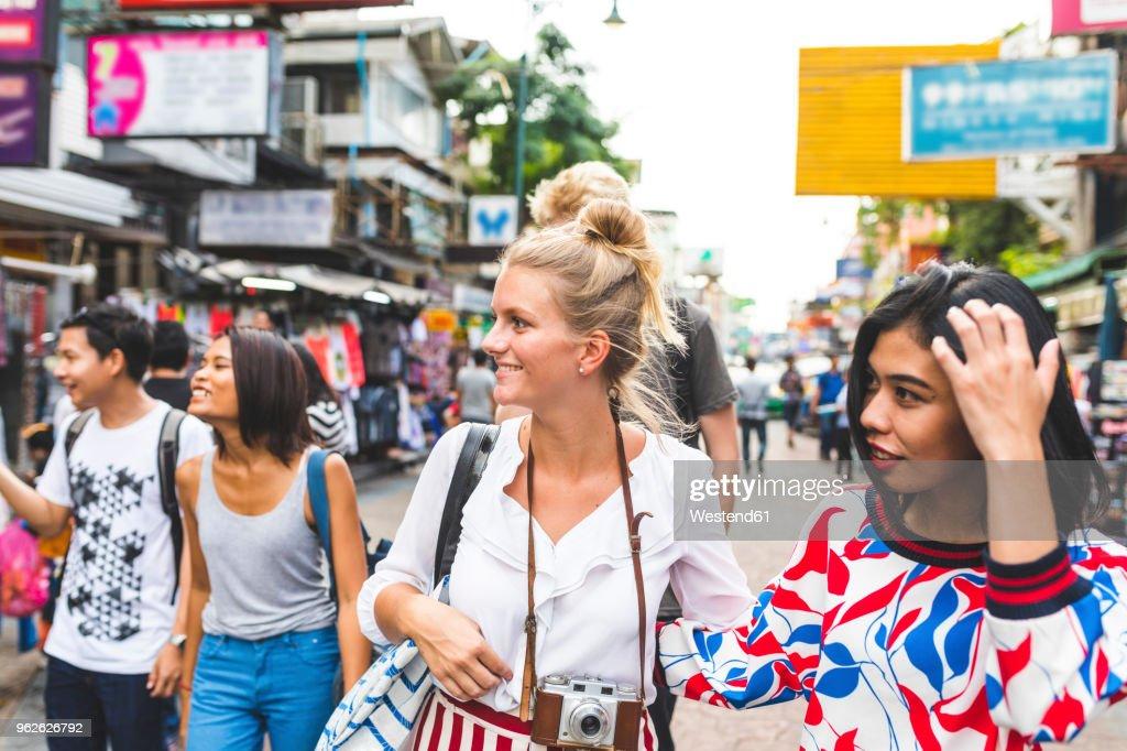 Thailand, Bangkok, Khao San Road, group of friends exploring the city : Stock Photo