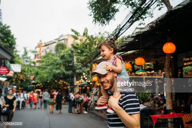 thailand, bangkok, portrait of smiling father and daughter on khao san road - modern manhood stock pictures, royalty-free photos & images