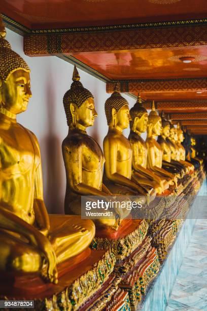 Thailand, Bangkok, row of Buddha statues at Grand Palace