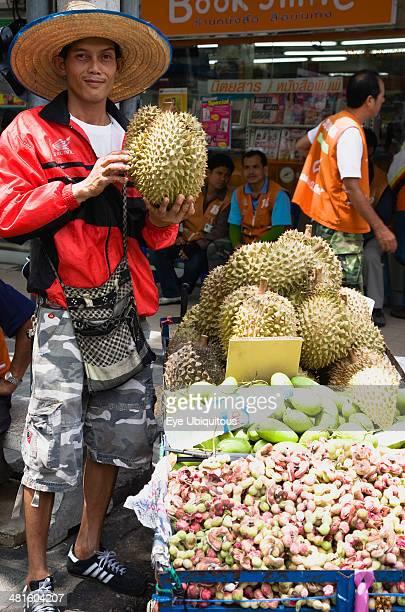 Thailand Bangkok Thai man selling Durian fruit from cart