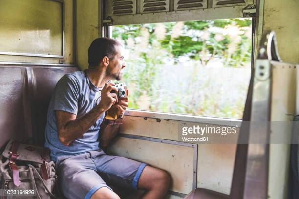 thailand, bangkok, tourist travelling by local train - trainold stock pictures, royalty-free photos & images