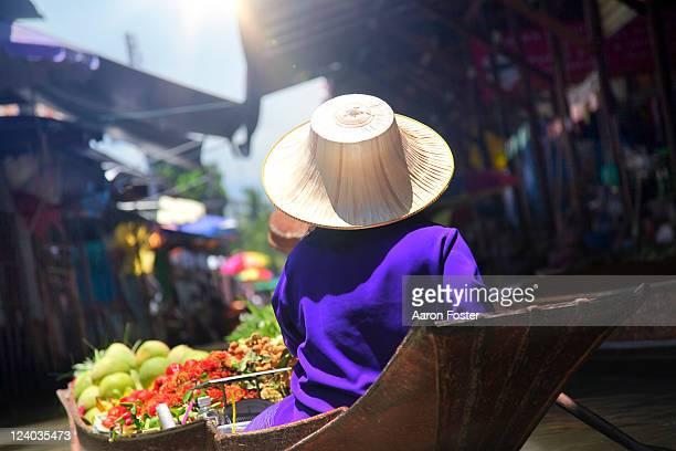 Thailand, Bangkok, vendor paddling boat in float