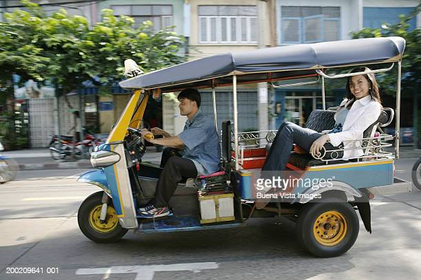 thailand, bangkok, young woman in taxi, smiling, portrait - auto rickshaw stock pictures, royalty-free photos & images