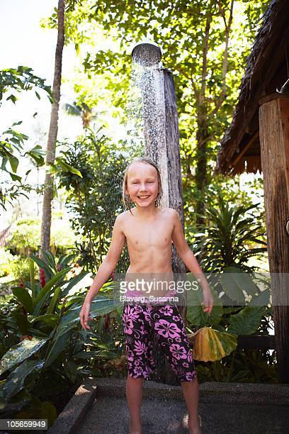 thailand, boy taking shower - kids taking a shower stock photos and pictures