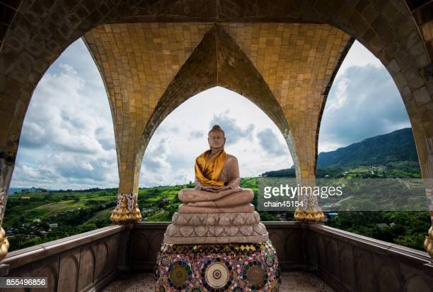 Thailand Buddha in the natural landscape view for buddhism to pray during travelling. religion and travel concept.