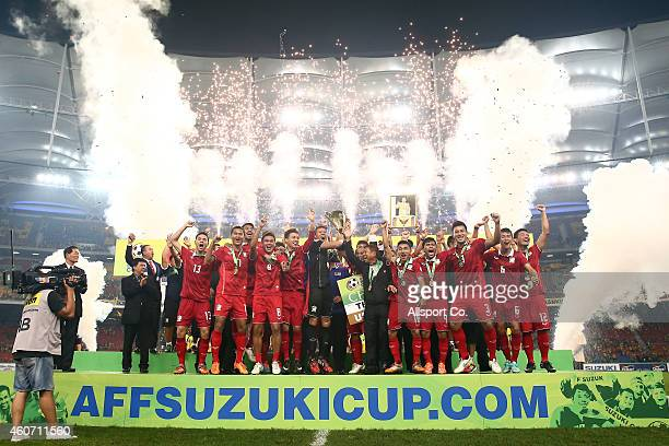 Thailand celebrates after they won the AFF Suzuki Cup by beating Malaysia 4-3 on aggregate during the 2014 AFF Suzuki Cup 2nd leg final match between...