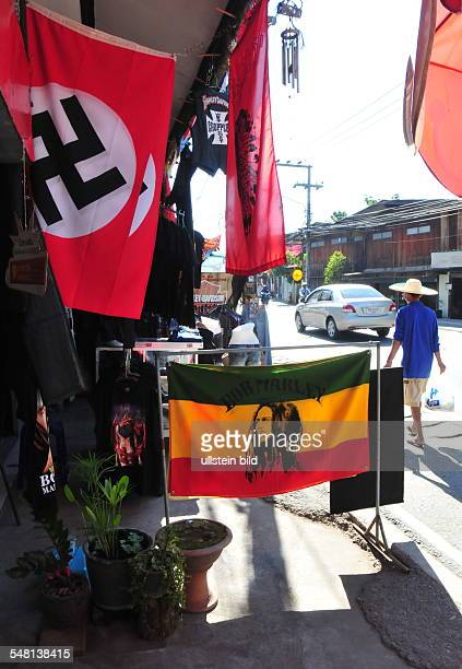 Thailand Chiang Mai Borsang street vendor is selling flags with swastika