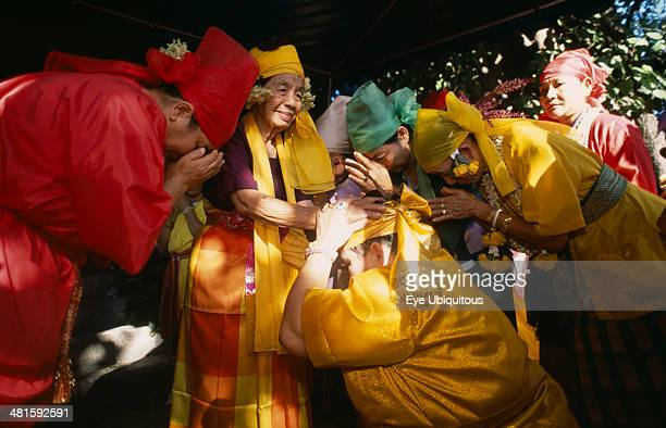 Thailand Chiang Mai Sect of Spirit Worshippers at prayer and receiving blessing