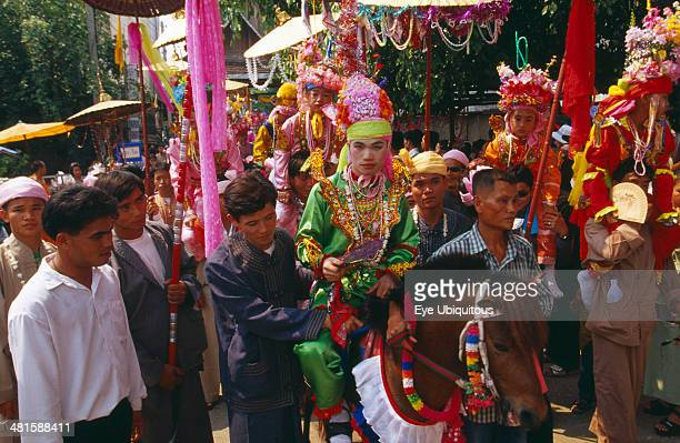 Thailand Chiang Mai Shan Poi San Long Crystal Children ceremony with Luk Kaeo in costume riding a pony in parade to Wat Pa Pao