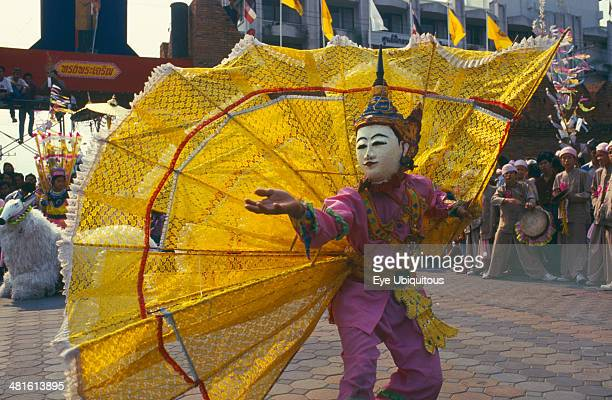 Thailand Chiang Mai Shan Poi San Long Crystal Children ceremony dancer with large yellow fan costume
