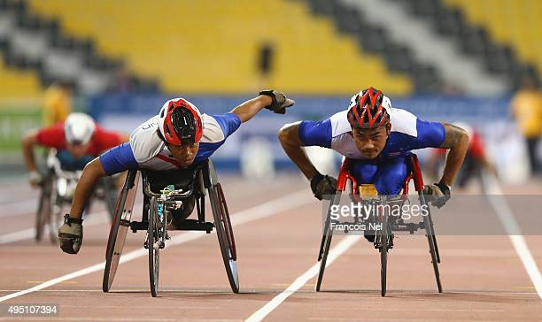 Thailand compete in the men's 4x400m T53/54 final during the Evening Session on Day Ten of the IPC Athletics World Championships at Suhaim Bin Hamad...