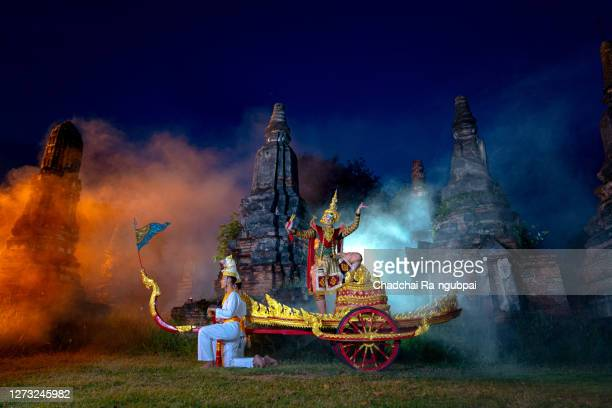 thailand culture khon performance arts acting entertainment dance traditional costume. asia acting dancing pantomime show.giant tos sa kan in a golden mask is on chariot to go to sida. - hindu god stock pictures, royalty-free photos & images