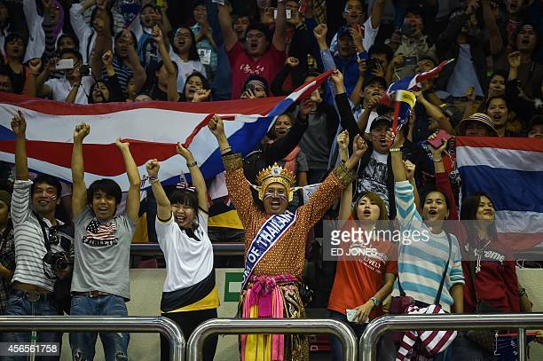 Thailand fans celebrate their win against South Korea during the men's regu sepaktakraw gold medal final event of the 17th Asian Games at the Bucheon...