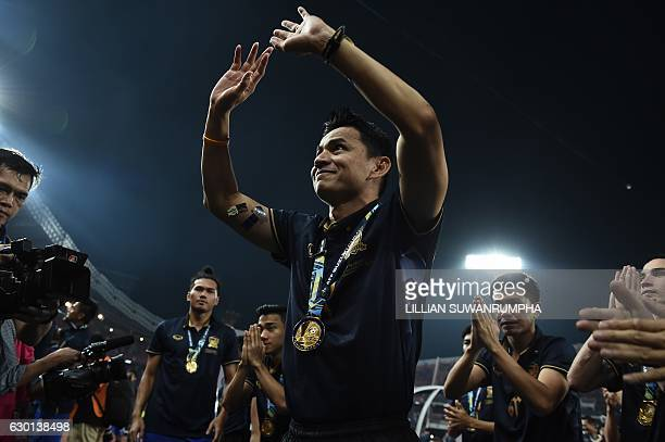Thailand football manager Kiatisuk Senamuang celebrates with his team after winning the AFF Suzuki Cup Final between Thailand and Indonesia at...