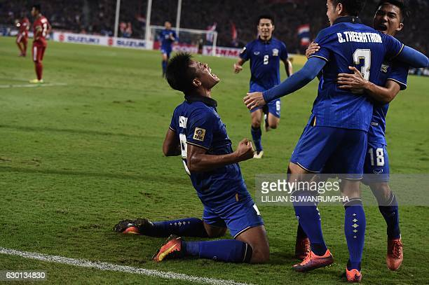 Thailand football player Sirod Chatthong celebrates after scoring against Indonesia during the second leg of the AFF Suzuki Cup Final between...