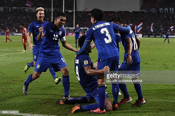 Thailand football players celebrate after Sirod Chatthong scored against Indonesia during the second leg of the AFF Suzuki Cup Final between Thailand...