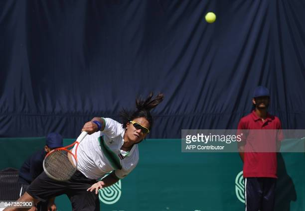 Thailand Kittiphong Wachiramanowong return the ball to his opponent AisamUlHaq Qureshi from Pakistan in the Davis Cup AsiaOceania GroupII match...