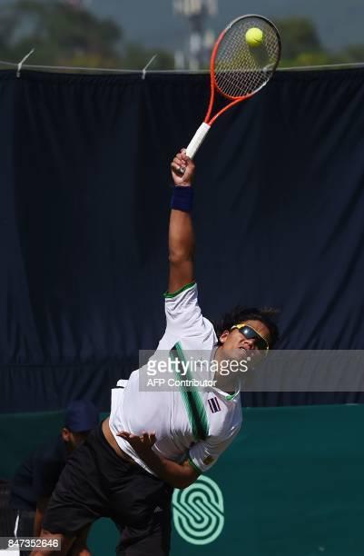 Thailand Kittiphong Wachiramanowong serves during his Davis Cup AsiaOceania GroupII singles tennis match against Pakistan's Aisam ul Haq Qureshi at...