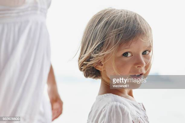Thailand, Ko Yao Noi, portrait of little girl with mother on the beach