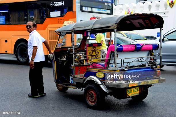 thailand man with his tuktuk