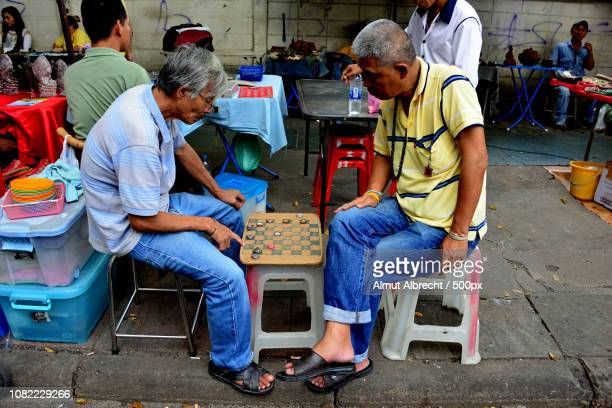 thailand men playing a game on the street